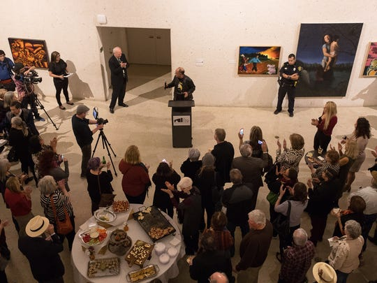 "People stand around a podium as Cheech Marin speak during the reception for his showcase ""Los Tejanos: Chicano Art from the Collection of Cheech Marin"" at the Art Museum of South Texas on Thursday, Jan. 11, 2017."