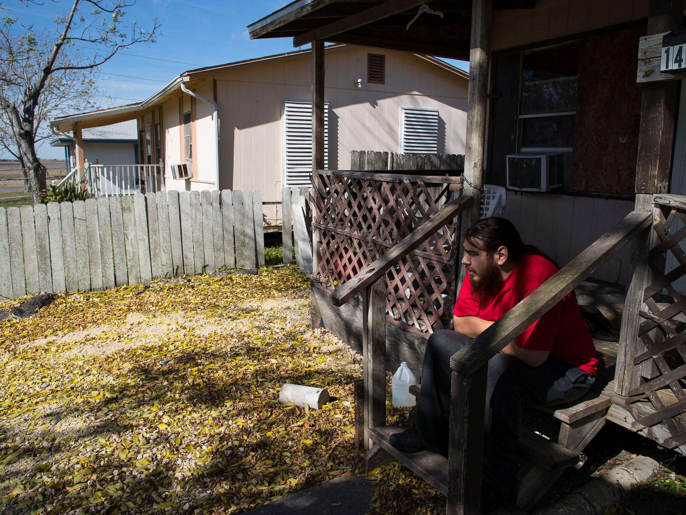 Victoriano Vasquez sits on the front porch of his in-laws' home on Dorado Street. The home, under a flood map proposed in 2015, would be considered as being in a floodway. The area was classified in 1985 flood maps as being at low risk for flooding.