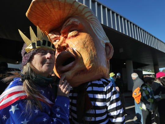 Huge papier-mache Trump heads have become a staple at rallies opposing his administration's policies.