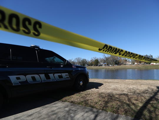 The Tallahassee Police Department investigates a death at Carter Howell Strong Park where they located a body in the pond Monday, Jan. 15, 2018.