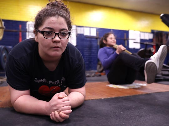 Moody High School wrestlers Kacie Rodriguez (left) and Amanda Gutierrez work out Thursday, Jan. 18, 2018. Rodriguez is ranked in the top 10 in the country in her weight class.