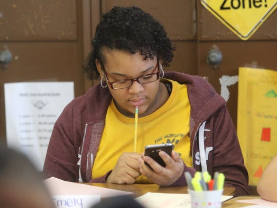 Seventh grader Emely Nunez tries to solve a problem