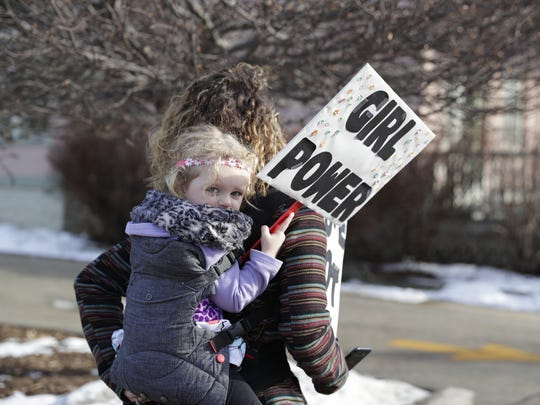 Peighton Letizia, 3, holds a 'girl power' sign during the Women's March Saturday in Green Bay.