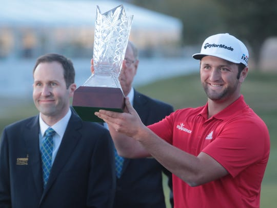 Jon Rahm, the 2018 CareerBuilder Challenge champion, holds up the trophy after a four-hole playoff on Sunday.