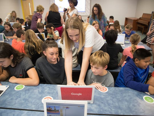 Google presenter, Tessa Marton works with Gulf Elementary School students during Google's CS First Roadshow that teaches kids about the importance of STEM education through an interactive coding presentation.