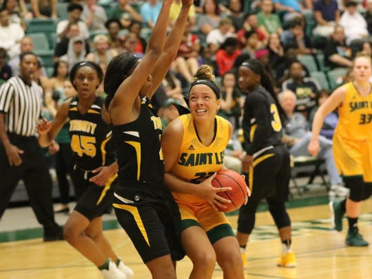Vestal graduate Alani Gallagher, right, is averaging 7.7 points and 5.5 rebounds for Saint Leo University.
