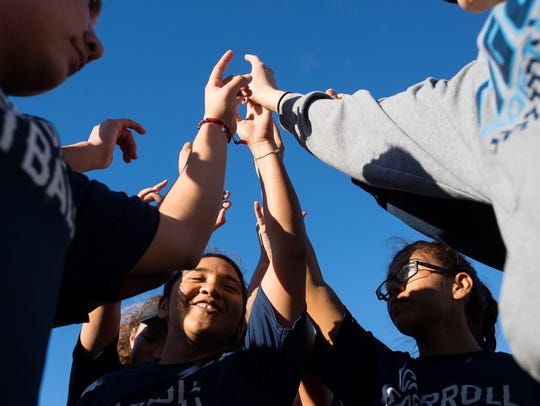 Carroll softball players huddle during practice at