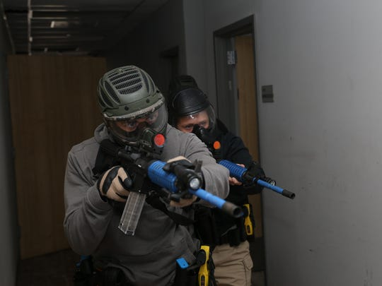Corpus Christi Police Academy Cadets enter a hallway of an abandonded building during an active shooter training exercise on Jan. 19, 2018.