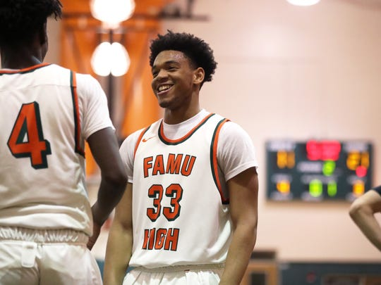 FAMU DRS' Marquis Davis laughs with his teammates during