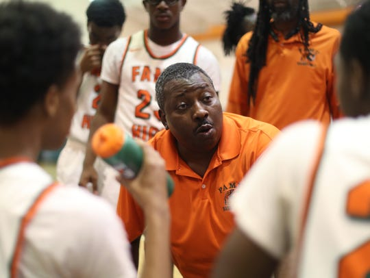 FAMU DRS Head Coach Sean Crowe talks to his team during