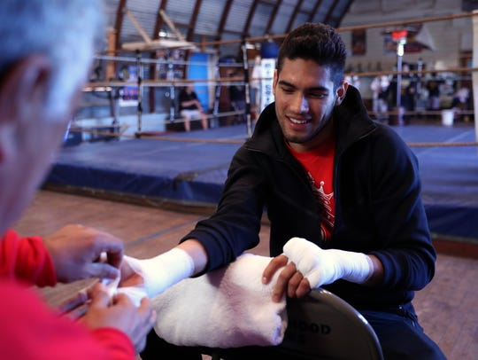 Gilberto Ramirez, of Mexico, gets his hands wrapped
