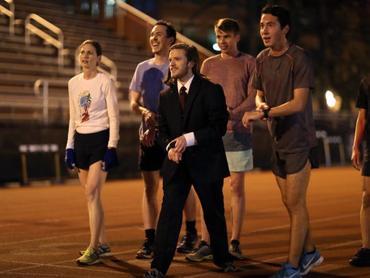 "Trevor Sununu, an FSU student who is going to attempt the Guinness world record for fastest marathon in a three-piece business suit, trains at the Mike Long Track on the university's campus. ""I'm probably not going to get any other running record, but it is hard to be number one at something – even if it is a silly thing,"" said Sununu."