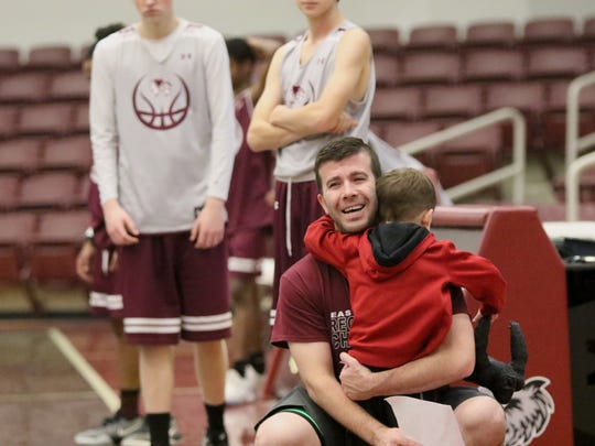 Michael Seger gets a big hug from his youngest son, Brayden Parker in the middle of practice.