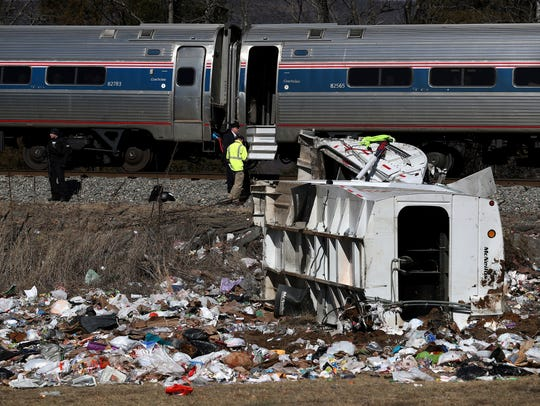 Emergency personnel work at the scene of a train crash