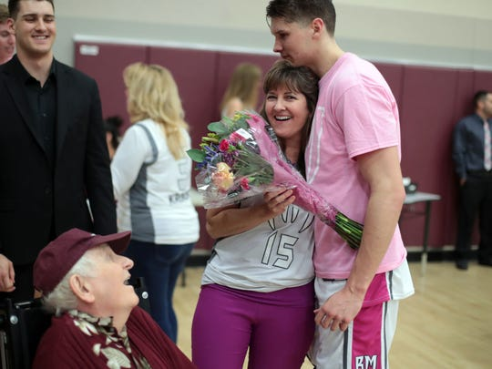Rattler Bryan Talley hugs his mother Lisa Talley as his brother Isaac Talley and grandfather Norman Edgmon look on during senior night at Rancho Mirage High on Friday, Feb. 2, 2018. Another knee injury has stopped Talley from playing so far this season.