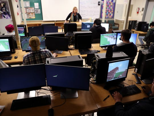 Students in Katherine Hewett's class at King High School work together to create the Winchester Mystery House in Minecraft on Friday, February 2, 2018. Ten years ago she launched a class that allows students to work with Minecraft in the classrooms.