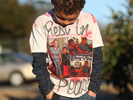 Jeremiah, 10, wears a shirt in honor of his mother
