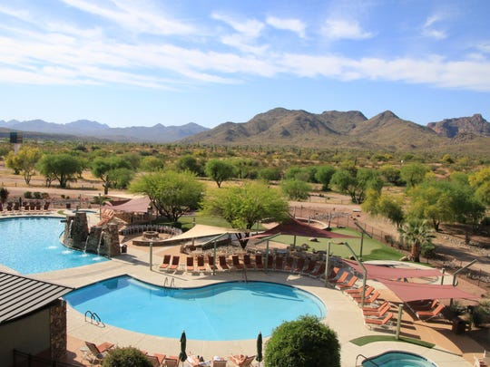 The view to the back of the We-Ko-Pa Resort includes a pool, desert and mountains.