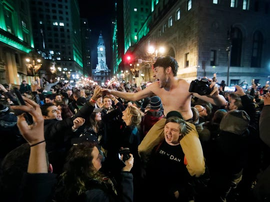 Philadelphia Eagles fans celebrate the team's Super Bowl victory in downtown Philadelphia Sunday night.