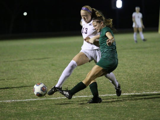 Estero junior Maggie Struble fights for possession