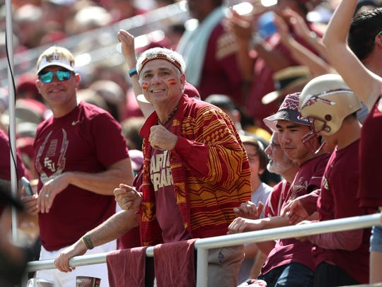 Mark Bartell dances in the stands as the Seminoles