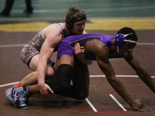 Clarksville High's Gabe Smith (left) tries to stay