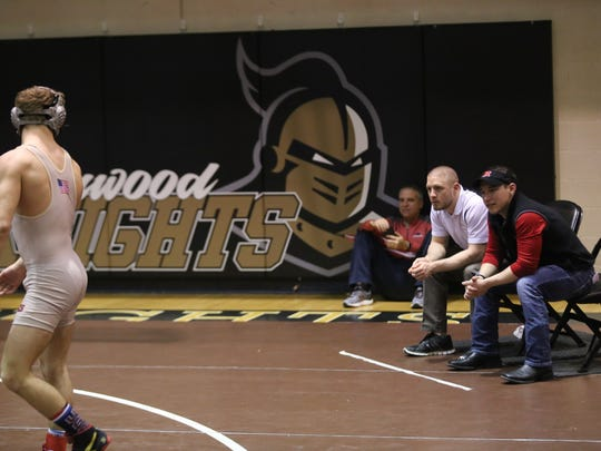 Rossview wrestling coach Jeff Price (far right) gives
