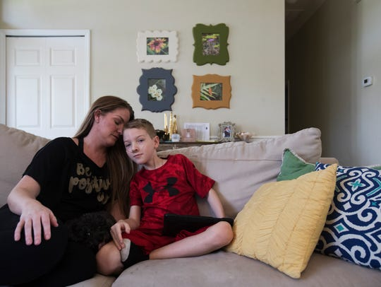 Brandi Lawrey shares a moment with her son Gavin on