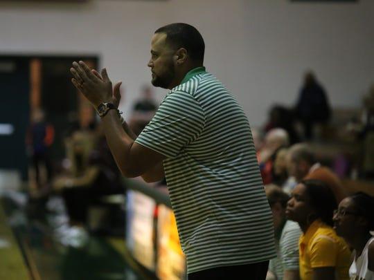 Northwest girls coach Aaron Wallus claps his hands