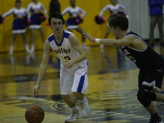 Clarksville Academy guard Noah Parker sets up his team's