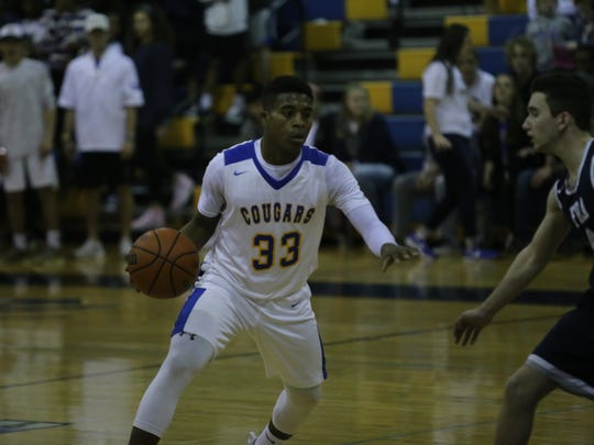 Clarksville Academy's Jacobi Milan (33) looks for room