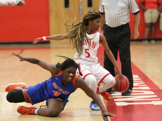 Immokalee point guard Cheryrokey Christopher (5) tries to keep the ball inbounds during the Class 6A Region 3 quarterfinal between Bradenton-Southeast and Immokalee on Thursday, Feb. 15, 2018.