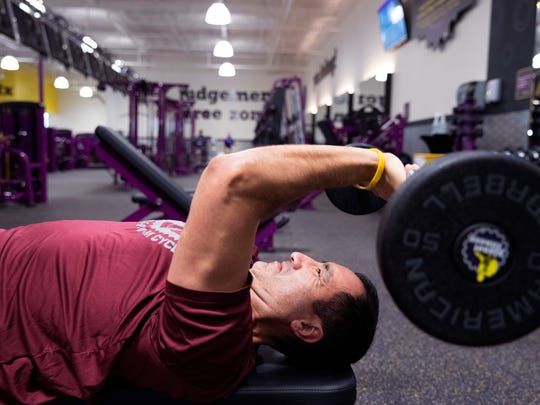 Roger Flores works out at the new Planet Fitness in