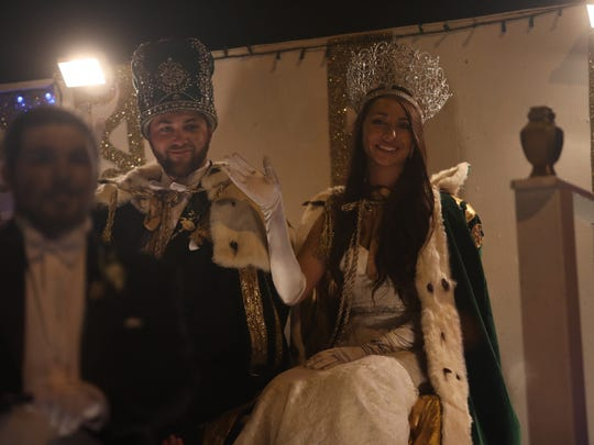 King TJ Mann and Queen Andrea Globetti wave from the Royal Court of Edisonia float during the 2018 Edison Festival of Light Grand Parade.