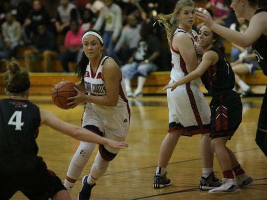 Henry County's Gracie Osbron drives to the basket against