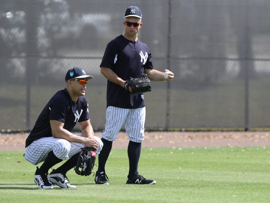 Giancarlo Stanton and Brett Gardner in the outfield