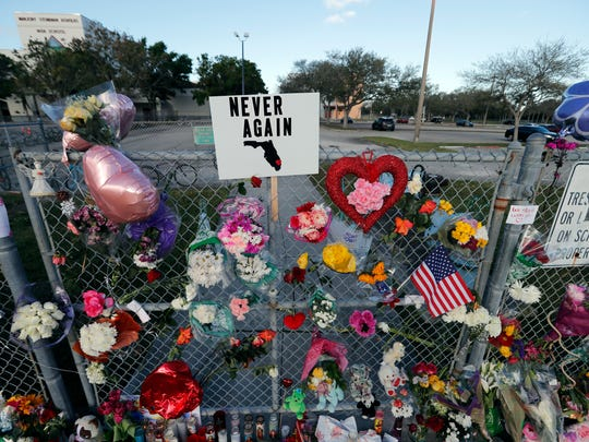 A makeshift memorial is seen outside the Marjory Stoneman