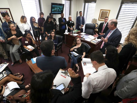 High school students from Broward County, including Stoneman Douglas, where seventeen people were killed and fifteen more injured by shooter Nikolas Cruz, speak with Senator Wilton Simpson, top right, on Tuesday at the Capitol in Tallahassee about implementing measures to ban the sale of weapons like the AR-15 used by Cruz.