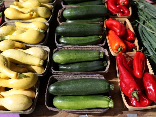 Fresh squash, zucchini and red peppers at the Market