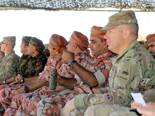 2nd Brigade commander Col. Chuck Lombardo watches a live fire exercise with leaders from the Omani Land Forces during the Inferno Creek exercise.