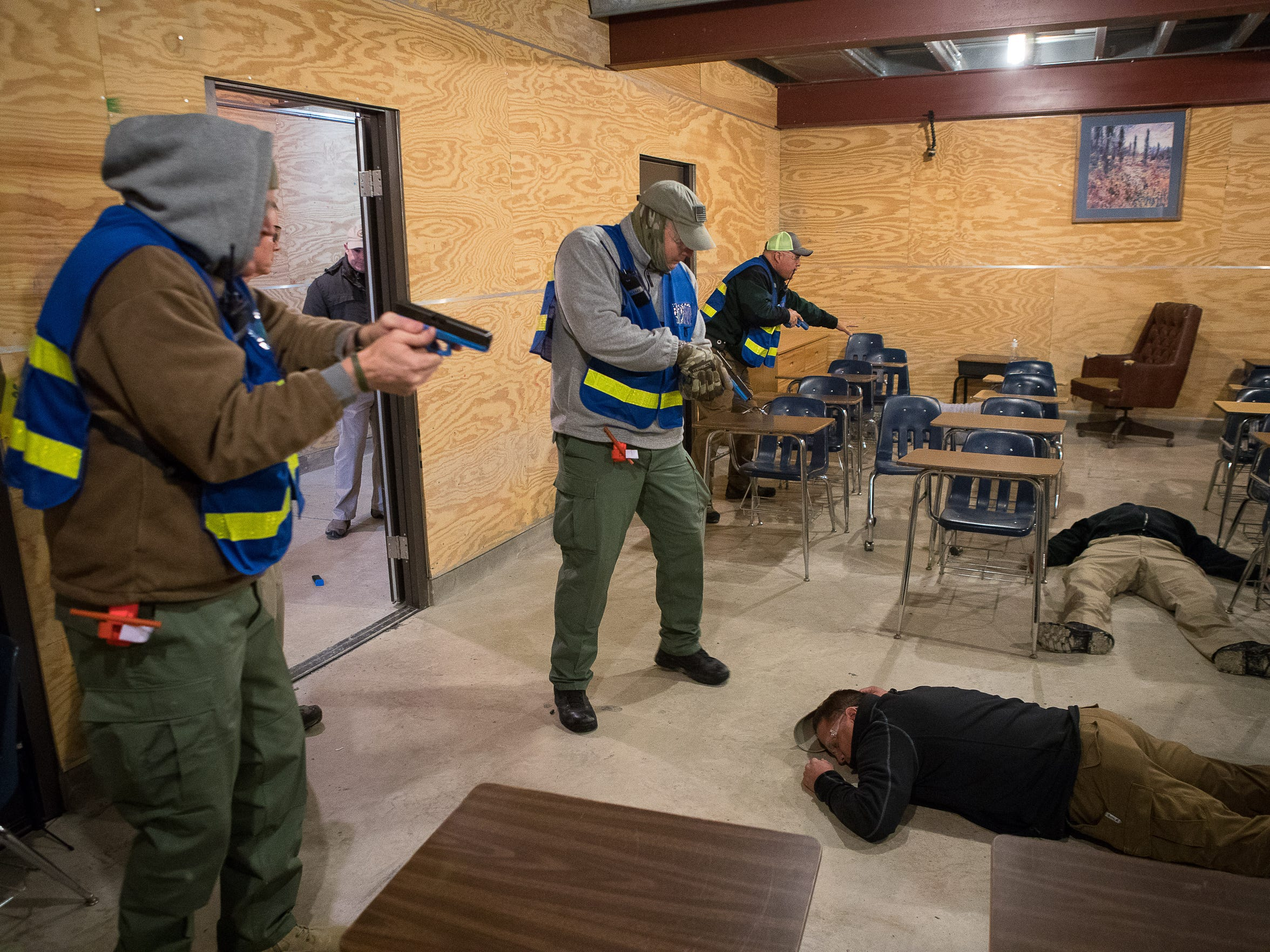 Police officers clear a room as they take part in active shooter training conducted by Advanced Law Enforcement Rapid Response Training: Center in Maxwell, Texas on Feb. 14, 2018.