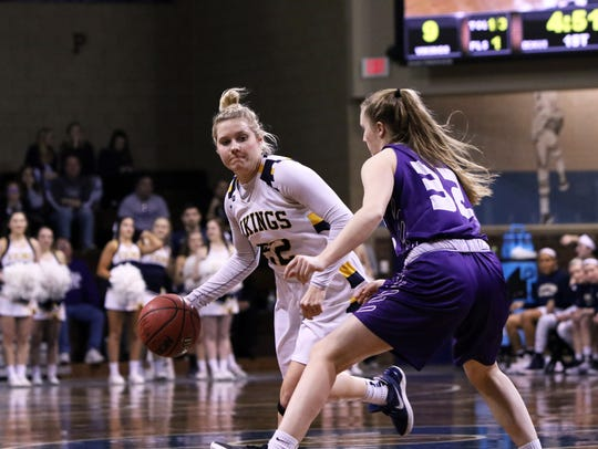 Lynsey Prosser of Augustana looks to get past the defense