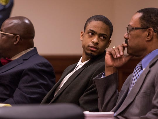 Curtis Shelton Jr. looks to his Defense Attorney Karl