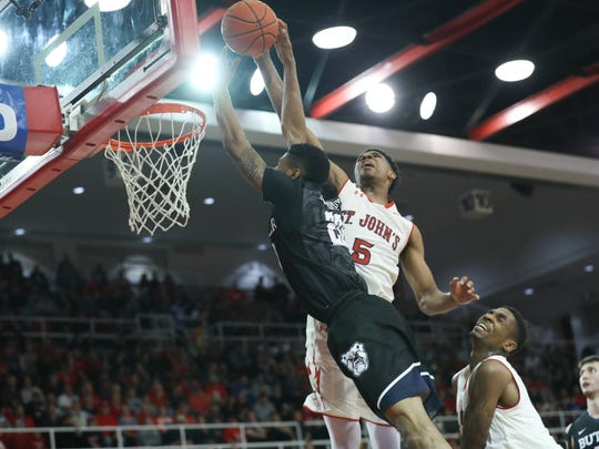 St. John's Red Storm guard Justin Simon (5) takes Butler