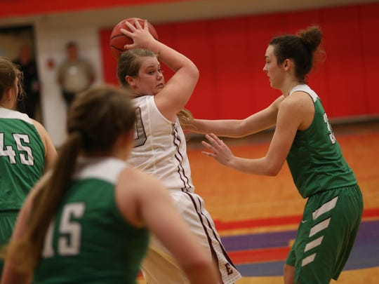 East Robertson's Hannah Mills keeps the ball away from