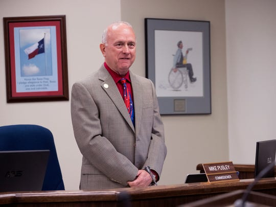 Nueces County Commissioner Mike Pusley attends his