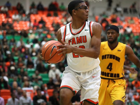 FAMU's Brendon Myles looks to save the ball against Bethune-Cookman as the Rattlers fall 89-77 at the Al Lawson Center on Thursday, March 1, 2018.