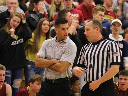 Roosevelt coach Mitch Begeman discussing a call during