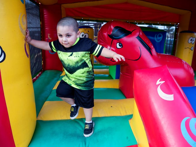 Javier Trevino III, 3, plays in a bounce house at the