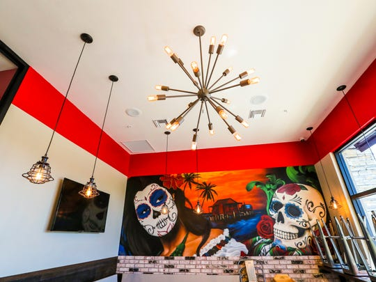 The Chronic Tacos location in Fort Myers, Florida features a spray painted mural by artist TEWSER.